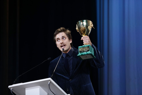 Luca Marinelli receives the Coppa Volpi for Best Actor Award for Martin Eden the Award Ceremony during the 76th Venice Film Festival