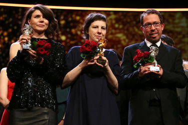 Award winner Malgorzata Szumowska_ Adina Pintilie and Marcelo Martinessi pose after the closing ceremony during the 68th Berlinale International Film Festival