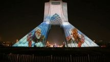 The symbol of Tehran lights up in memorial of resistance martyrs / Azadi tower performs video mapping of  Qassem Soleimani