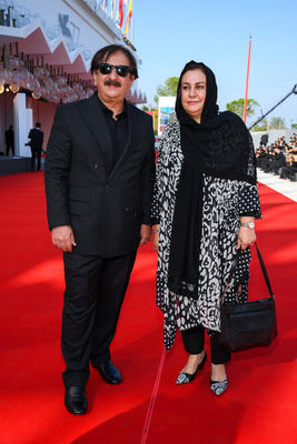 09 Director Majid Majidi and a guest walk the red carpet ahead of the movie Khorshid (Sun Children) at the 77th Venice Film Festival on September 06_ 2020 in Venice_ Italy.2