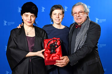 Bianca Oana_ Adina Pintilie and Philippe Avril pose with the Golden Bear award for Best Film _Touch Me Not_ at the award winners photo call during the 68th Berlinale International Film Festival