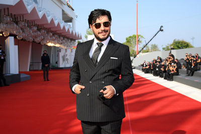 05 Javad Ezzati walks the red carpet ahead of the movie Khorshid (Sun Children) at the 77th Venice Film Festival on September 06_ 2020 in Venice_ Italy.1