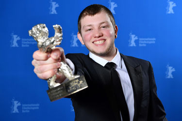 Anthony Bajon poses with the Silver Bear for Best Actor for _The Prayer_ at the Award Winners photo call during the 68th Berlinale International Film Festival