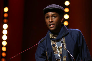 Samuel Ishimwe speaks after receiving the Silver Bear Jury Prize in the short film category for _Imfura_ during the closing ceremony of the 68th Berlinale International Film Festival