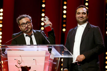 Alonso Ruizpalacios (L) and Manuel Alcala receive the Silver Bear for Best Script for _Museo_ at the closing ceremony during the 68th Berlinale International Film Festival