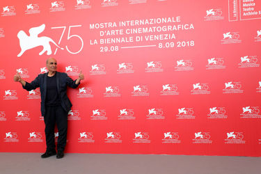 093 Director Amir Naderi attends Magic Lantern photocall during the 75th Venice Film Festival